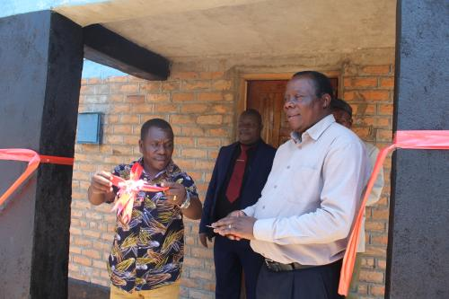 Magomero (left) and Golowa cutting the ribbon to mark official opening of the hostel