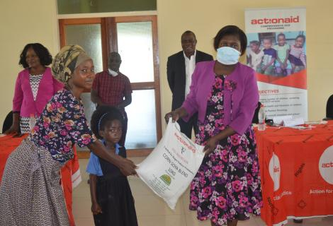 ActionAid Malawi Vice Board Chairperson, Professor Dorothy Nampota (right) making a symbolic presentation of the donation to ECD centre