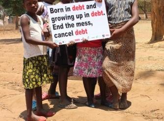 Children calling for debt cancellation on the sidelines of the campaign activity in Nsalu, outskirts of Lilongwe